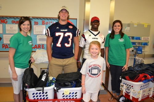 Samford football visits hospital