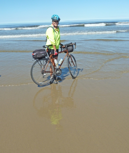 Holloway reaches the Pacific Ocean on bike.
